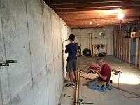 Basement Studio in Upstate New York-dad-framing-brother-doing-demo.jpg