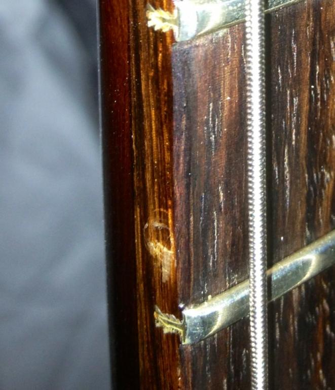Repairing a neck ding with nail lacquer - genius or stupid